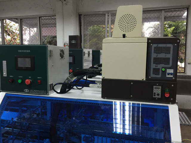 close view of YX-HS200 hotmelt box case sealing machine hot