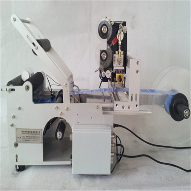 semi automatic round bottle labeling machine with date code