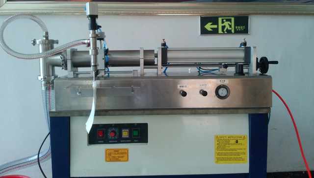 Malawian customer purchased YX-SF1-1000 semi automatic liquid juice filling machines