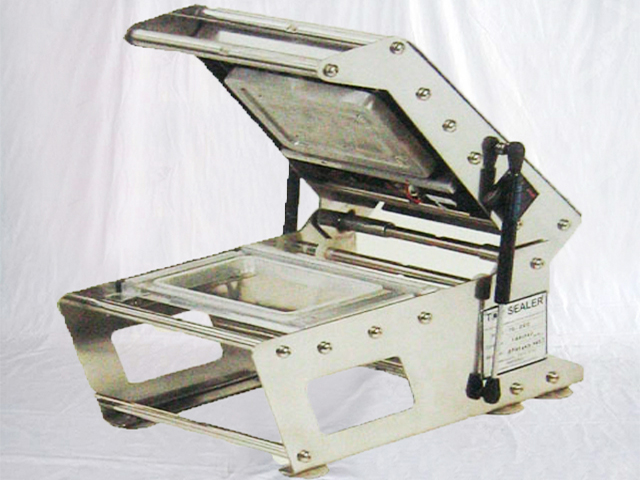 Canadian customer orders tray sealing machine semi automatic tabletop manual boxes sealer
