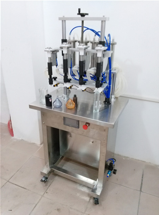Saudi Arabian customer ordered semi-automatic perfume filling line and packaging materials línea de embotellado de perfumes