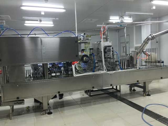Iranian customer bought two lanes coffee powder filling sealing machine linear cups filler sealer
