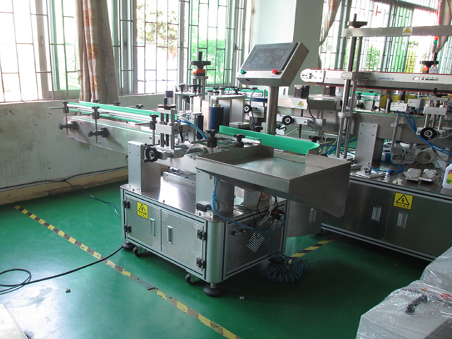 UAE customer orders automatic linear labeling machine metal cans labeller with rotary table model YX-630AA