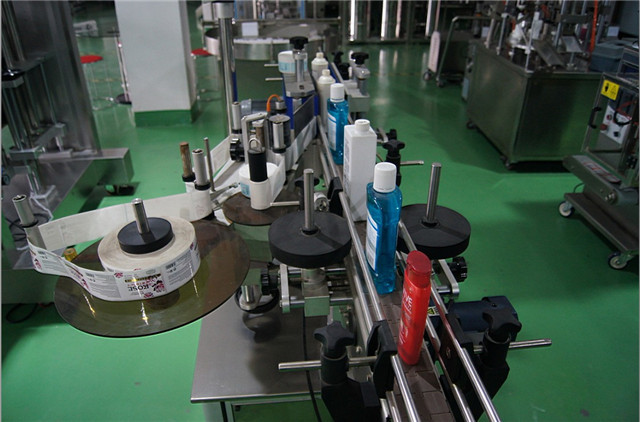 close up photos of round bottles automatic labeling machine