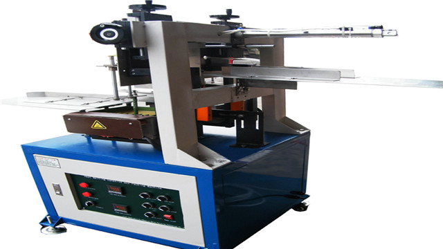 front view of semi-automatic hot melt glue box sealing machi