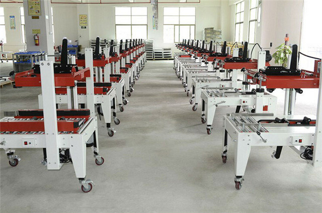 Plant workshop for carton sealing machines various model for