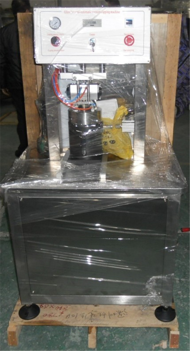 overview of semi automatic vacuum capping machine.jpg